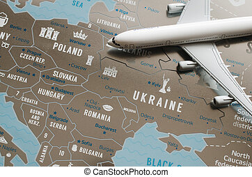 Travel concept. Airplane model on Europe map background.
