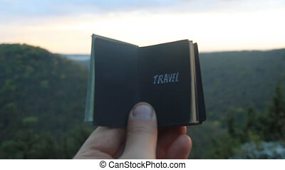 Travel concept. Book with the inscription
