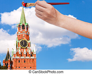 paintbrush paints the red star on Spasskaya tower - travel...