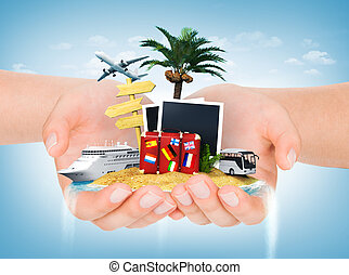 Travel concept. Hands holding iceland with palm, suitcase, photo
