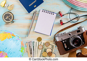 Travel concept photo on blue wooden background priparation for travelling