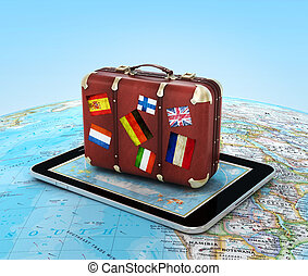 Travel concept. Suitcase on the tablet PC.