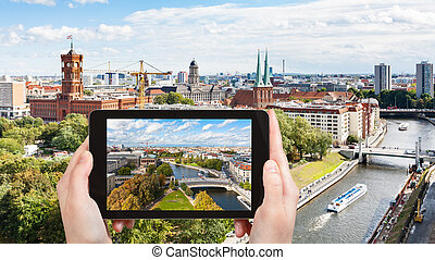 tourist photographs Berlin city with Spree river - travel...