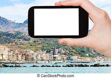 tourist photographs Giardini-Naxos town in Sicily - travel...