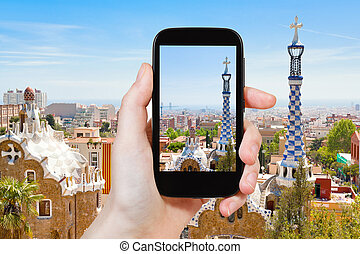 tourist taking photo of Barcelona landscape