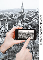 tourist taking photo of Bern city