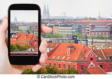 tourist taking photo of Copenhagen city