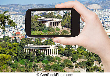 tourist taking photo of temple in Athens