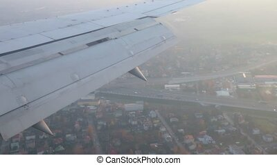 Travel concept. View from airplane window. An airplane takes off. Foggy weather.