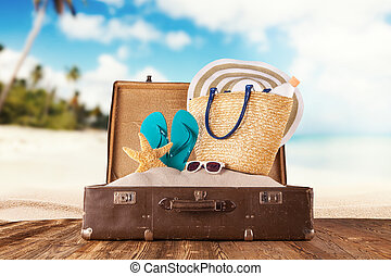 Travel concept with old suitcase on wooden planks full of ...
