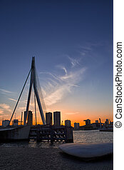 Travel Concepts, Ideas and Destinations. Picturesque View of Erasmus Bridge in Rotterdan Before the Sunset. Vertical Image Composition