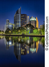 Travel Concepts. The Skyline of the Hague City (Den Haag) in the Netherlands. Shot During Blue Hour Time. Vertical Shot