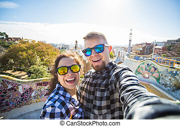 Travel couple happy making selfie portrait with smartphone...