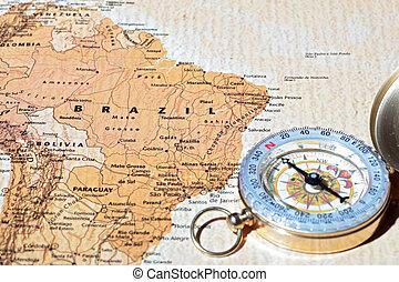 Travel destination Brazil, ancient map with vintage compass...