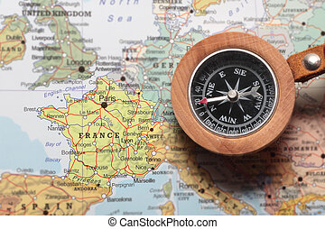 Travel destination France, map with compass - Compass on a ...