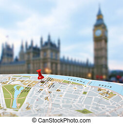 Travel destination London map push pin blur