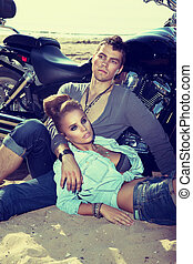 Travel destination. Man and woman resting near motorbike