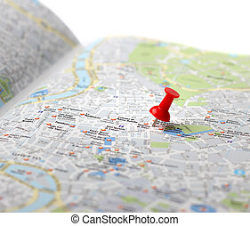 Red push pin pointing planned travel destination on city map