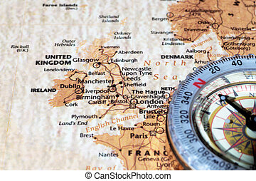 Travel destination United Kingdom and Ireland, ancient map with vintage compass