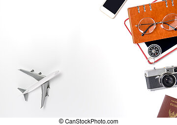Travel equipments with toy plane on white copy space