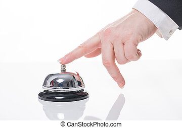 travel - female hand ring a bell at a hotel or reception
