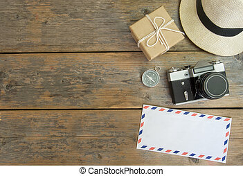 Travel flat lay - Camera, international envelope, hat and ...