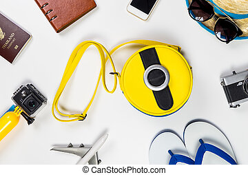 Travel gadgets and accessories on white background.