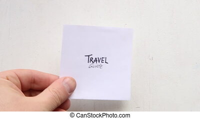 travel guide inscription - travel guide, hand and a piece of...