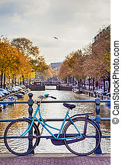 Travel Ideas. City of Amsterdam. Traditional Dutch Bicycle In Front of The Canal Fence in Amsterdam.