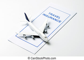 Travel insurance brochure with an airplane model on top