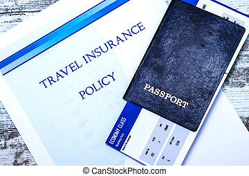 Travel insurance policy booklet with a boarding pass and a ...