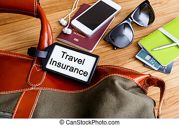 Travel insurance tag on travel bag