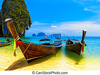 Travel landscape, beach with blue water and sky at summer. Thailand nature beautiful island and traditional wooden boat. Scenery tropical paradise resort
