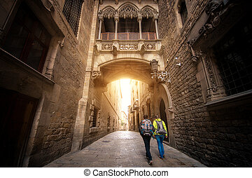 Bridge between buildings in Barri Gotic quarter of Barcelona