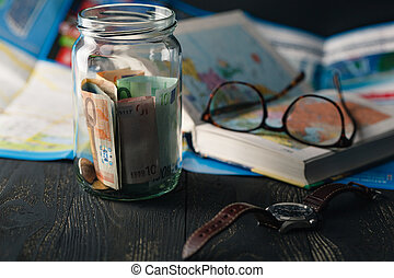 Travel money savings in a glass jar