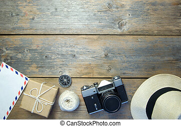 Travel objects over a wooden background