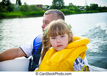 Travel of children on water in the boat