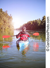 Travel on the river in a kayak