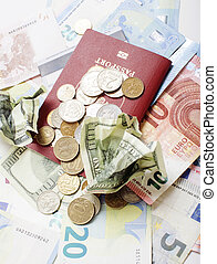 Travel on vacation lifestyle concept: cash money on table in mess with passport and change