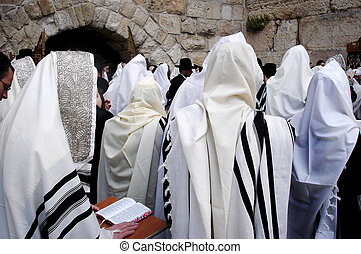 JERUSALEM - APRIL 07: Orthodox Jewish Pray at the Western Wall during the Jewish holiday of Passover on April 07 2008 in Jerusalem, Israel.