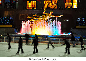 Travel Photos of New York - Manhattan - People ice skate at...