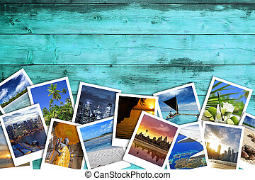 travel photos on turquoise wooden background - heap of ...