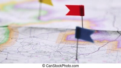 Travel plan and route marked on the map with colorful flag...