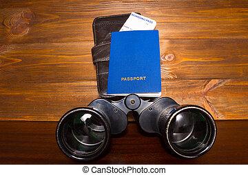 Travel planning - passport, boarding pass and binoculars - ...