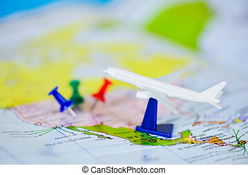 Travel planning with airplane destination points on a map pin - travel time or plan for travelling concept