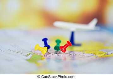Travel planning with airplane destination points on a map pin / travel time or plan for travelling concept