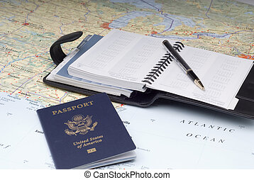 Travel Plans 3 - A US Passport and a day planner on a...