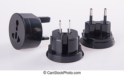 Travel plug adapter on a background