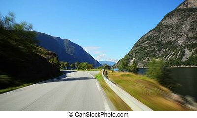 Travel - Road travel in Norway. Fast motion effect.