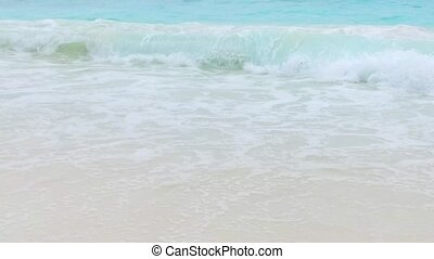 sea or indian ocean waves on beach - travel, seascape and...